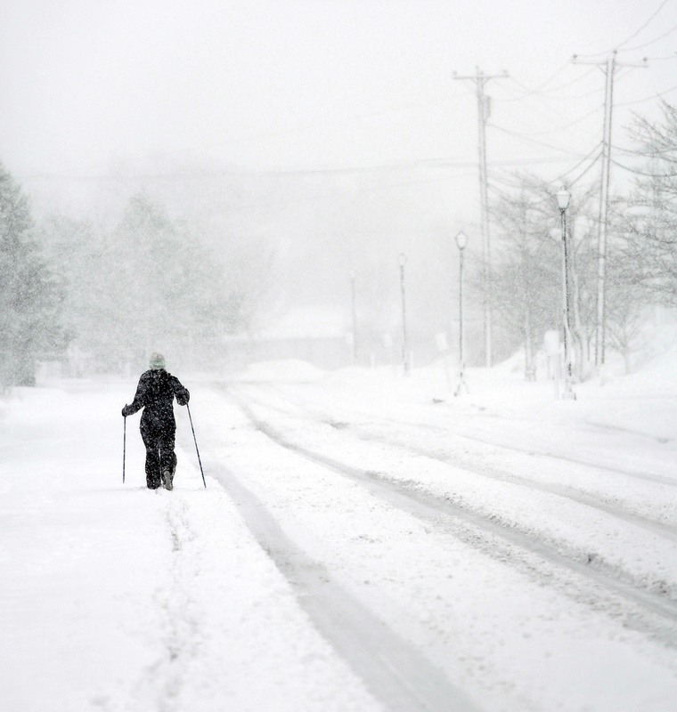 Leigh Turitz of South Portland skis down Madison Street in South Portland during the heavy snowfall Sunday morning.