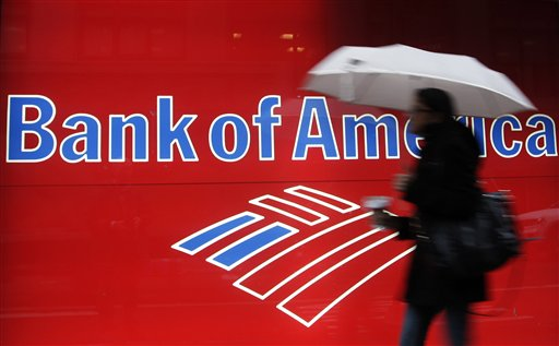 In this Dec. 7, 2012 photo, a woman passes a Bank of America office branch, in New York. Bank of America says its online banking website crashed Friday, Feb. 1, 2013 leaving customers unable to access their accounts. (AP Photo/Mark Lennihan)