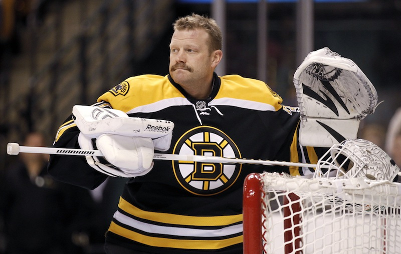 In this February 2012 file photo, Boston Bruins goalie Tim Thomas gets ready for an NHL hockey game between the Bruins and the Pittsburgh Penguins in Boston. Thomas, who has said he won't play this season, was traded by the Boston Bruins to the New York Islanders on Thursday, Feb. 7, 2013, for a conditional second-round draft choice either next year or in 2015.