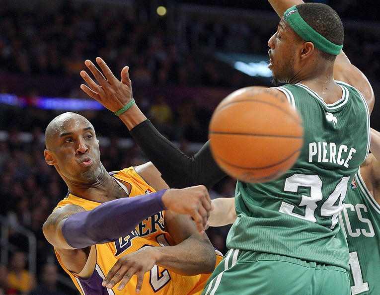 Lakers guard Kobe Bryant passes around Celtics forward Paul Pierce during the first half Wednesday in Los Angeles. The Lakers won, 113-99.