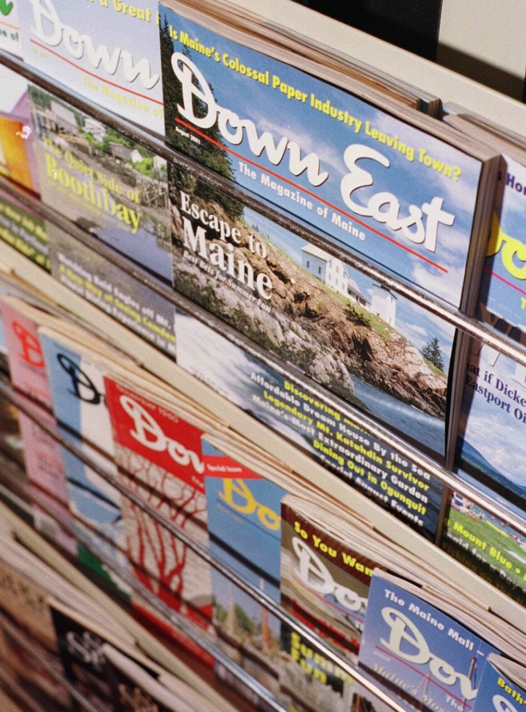 In this August 2001 file photo, editions of Down East Magazine, published in Rockport, Maine. The magazine is bucking the downsizing trend in periodicals and has set new publication highs consecutively over the summer months. (AP Photo/Michael C. York)