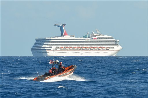 In this image released by the U.S. Coast Guard on Sunday, a boat belonging to the Coast Guard Cutter Vigorous patrols near the cruise ship Carnival Triumph in the Gulf of Mexico.