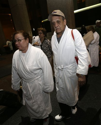 Weary passengers from the disabled Carnival Triumph cruise ship arrive by bus at the Hilton Riverside Hotel in New Orleans on Friday.