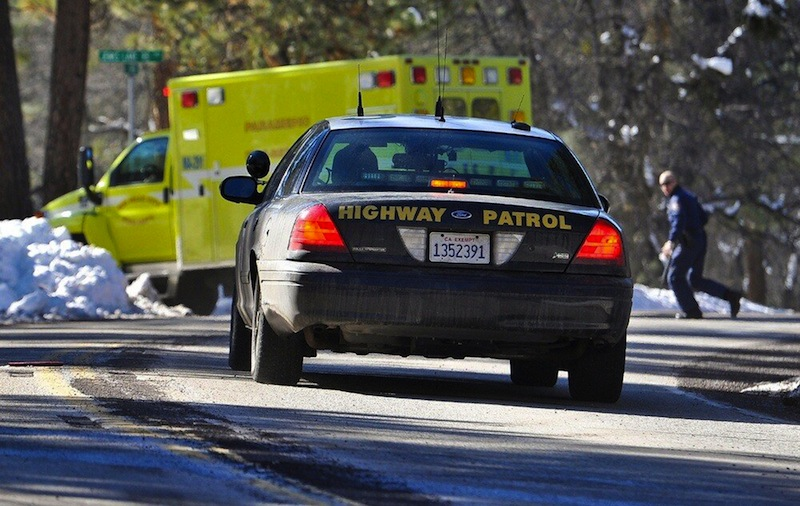 Law enforcement officials respond after Christopher Dorner, the fugitive ex-Los Angeles cop sought in three killings, engaged in a shootout with authorities that wounded two officers in the San Bernardino Mountains near Big Bear Lake, Calif., Tuesday, Feb. 12, 2013. (AP Photo/The Sun, Rachel Luna) MANDATORY CREDIT