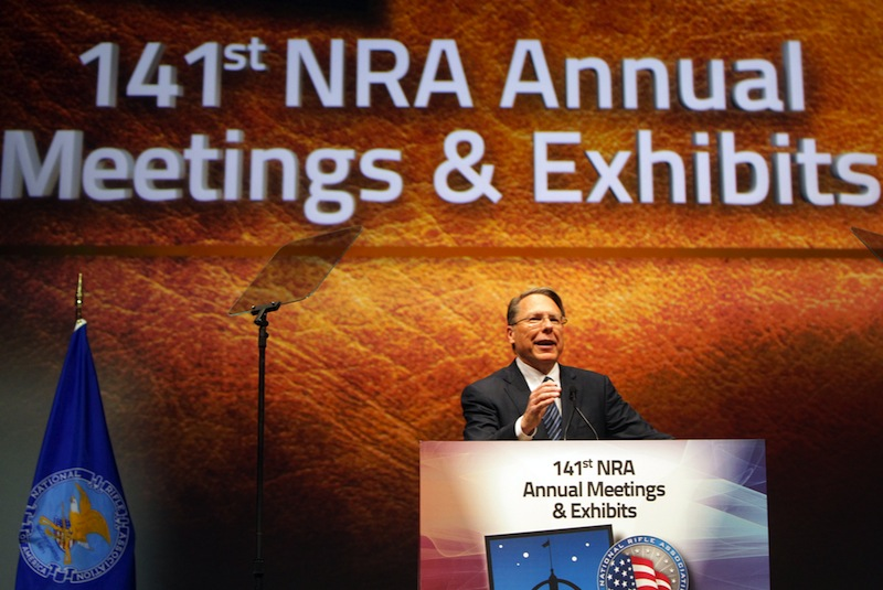 In this April 14, 2012, file photo, Wayne LaPierre Jr., executive vice president and chief executive officer of the National Rifle Association, speaks at its members annual meeting. LaPierre renewed his call for armed guards in all schools on Thursday.