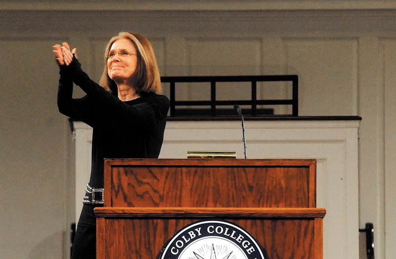 Gloria Steinem, a journalist and activist, applauds a capacity crowd at Lorimer Chapel at Colby College during her introduction as guest speaker for SHOUT Thursday.