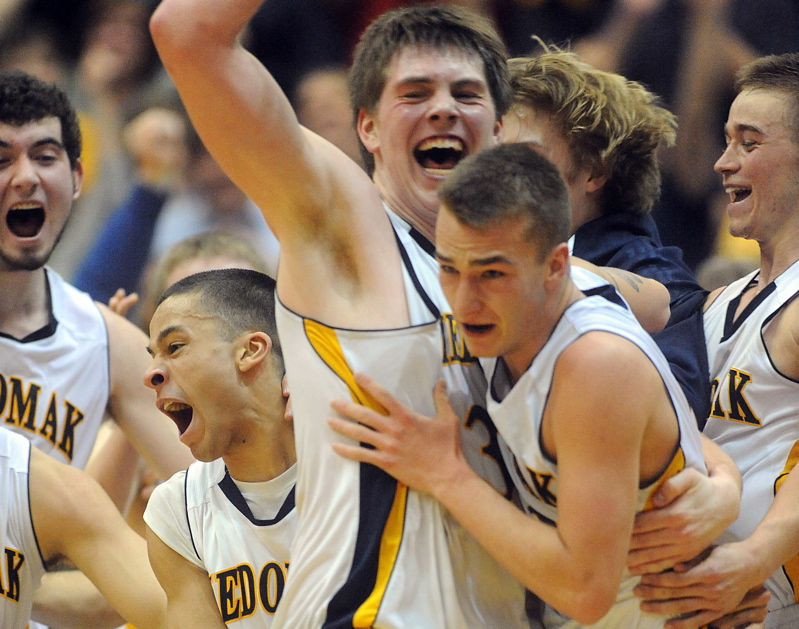Medomak Valley celebratesits win over MDI in the Eastern Class B championship game at the Bangor Auditorium Saturday.