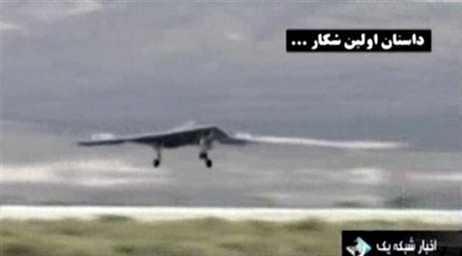 This undated image taken from video broadcast on Iranian state television purports to show a U.S. drone landing in Kandahar, Afghanistan. Iran's state TV broadcast the footage on Thursday.