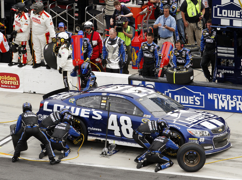 Jimmie Johnson pits for tires and fuel during the NASCAR Daytona 500 Sprint Cup Series auto race at Daytona International Speedway on Sunday in Daytona Beach, Fla.