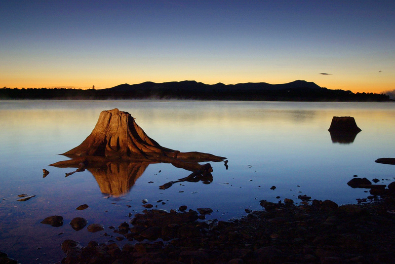 The first light of dawn silhouettes the Katahdin Range east of Chesuncook Lake, in Township 3, Range 13, in September 2001. New studies reframe the debate over whether Maine and the two-county Katahdin region would be better off with or without a national park and recreation area.