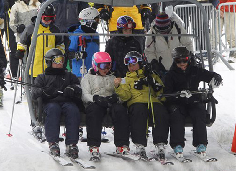 Skiers board a lift at the Sugarbush ski resort in Warren, Vt., Thursday. Last weekend's record snowfall is giving a big boost to the ski industry in northern New England and upstate New York.