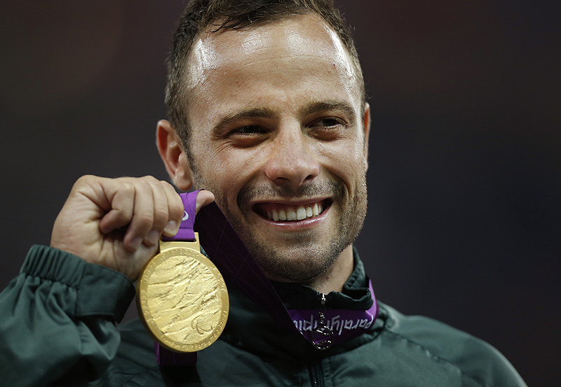 South Africa's Oscar Pistorius poses with his gold medal after winning the men's 400 meters T44 category final at the 2012 Paralympics, in London. Pistorius was arrested in the killing of Reeva Steenkamp, who was shot on Valentine's Day.