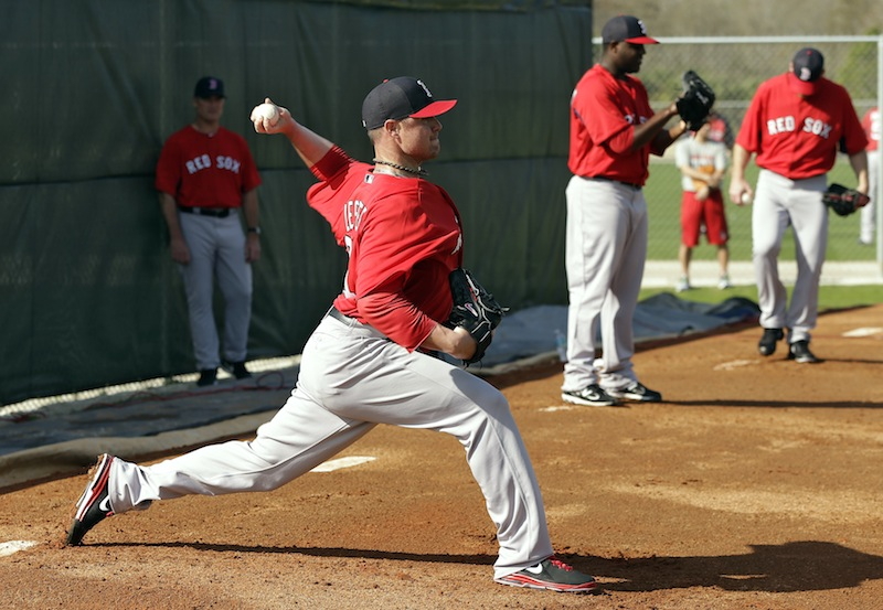 Boston Red Sox pitcher Jon Lester, front, throws a bullpen session during spring training Wednesday, Feb. 13, 2013, in Fort Myers, Fla. (AP Photo/Chris O'Meara)