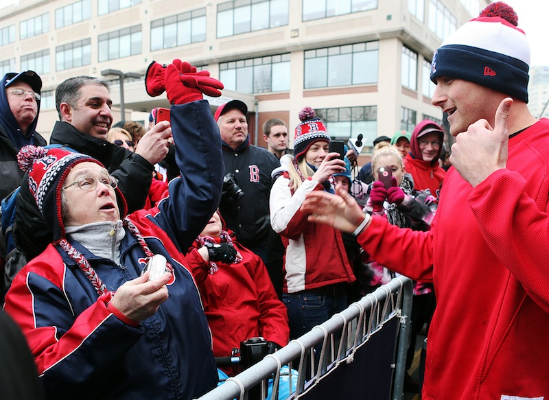 Boston Red Sox third baseman Will Middlebrooks greets fans outside Fenway Park on Tuesday, Feb. 5, 2013, in Boston. Red Sox fans turned out for 'Truck Day' at Fenway, the day the team sends off its equipment to Florida in preparation for spring training. Pitchers and catchers formally report to spring training a week from today but already, some players have been working out in Fort Myers. (AP Photo/The Boston Herald, Angela Rowlings) Fenway Park;Truck Day;Spring training;Boston Red Sox