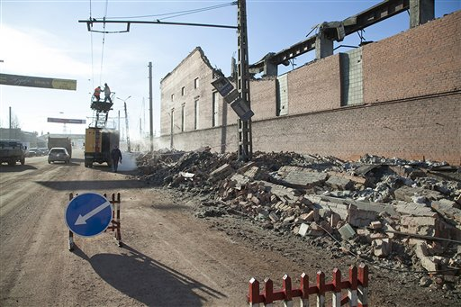 Municipal workers repair a damaged power circuit outside a zinc factory where a section of the roof collapsed when a meteorite exploded over the Chelyabinsk region on Friday.