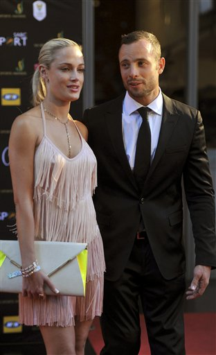 South African Olympic athlete Oscar Pistorius and Reeva Steenkamp, believed to be his girlfriend, attend an awards ceremony, in Johannesburg, South Africa, in this Nov. 4, 2012, photo.