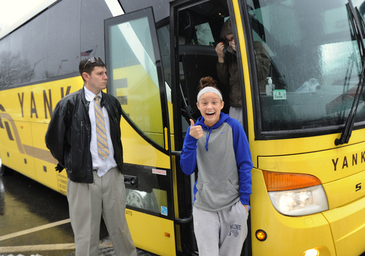 Members of the University of Maine women's basketball team stop at the Kennebunk rest area on the Maine Turnpike on their return to Orono following a bus accident in Massachusetts Tuesday evening. Brittany Wells, a freshman guard from Fishers, Ind., gives the thumbs up sign as she left the bus. At left is Yankee Lines bus driver Jason Stirk.