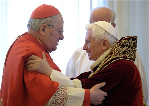 Pope Benedict XVI, right, and Cardinal Angelo Sodano, Dean of the College of Cardinals, hug each other on Monday after the pontiff announced during the meeting of Vatican cardinals that he would resign on Feb. 28.