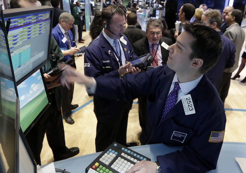 Specialist Robert Canzani, right, works at his post on the floor of the New York Stock Exchange Monday, Feb. 25, 2013. (AP Photo/Richard Drew)