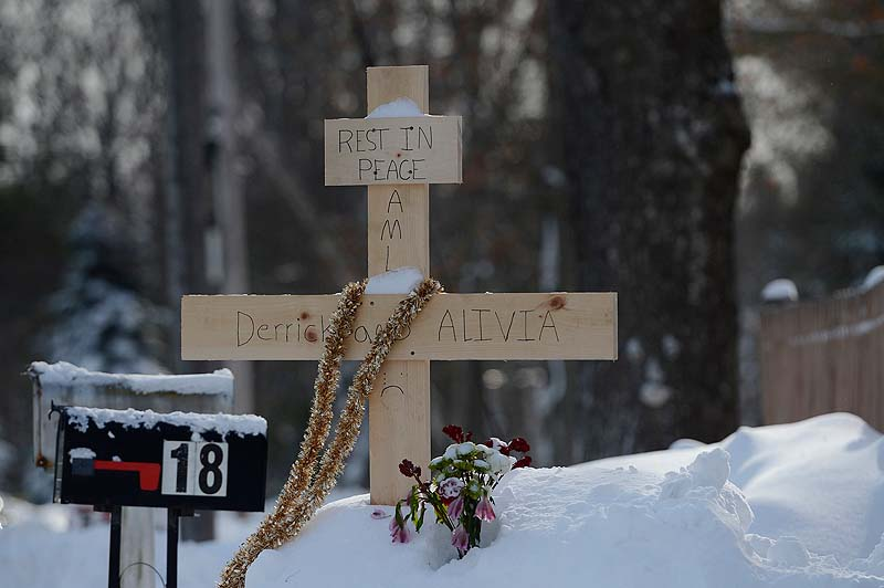 A makeshift memorial for Derrick Thompson, 19, and his girlfriend, Alivia Welch, 18. on Sokokis Rd. near the site of the shooting in Biddeford.