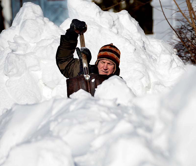 John Morrill Read of Saco shovels his way through the deep snow in an effort to get his vehicle out of his garage on School Street in Saco on Sunday.