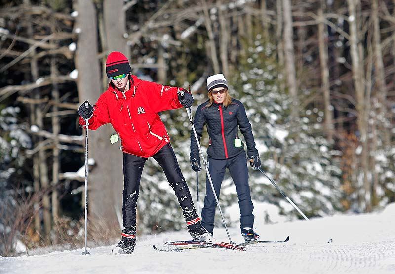Liam Bridgham of Scarborough skis with his mother, Kim, Sunday at Pineland Farms in New Gloucester.