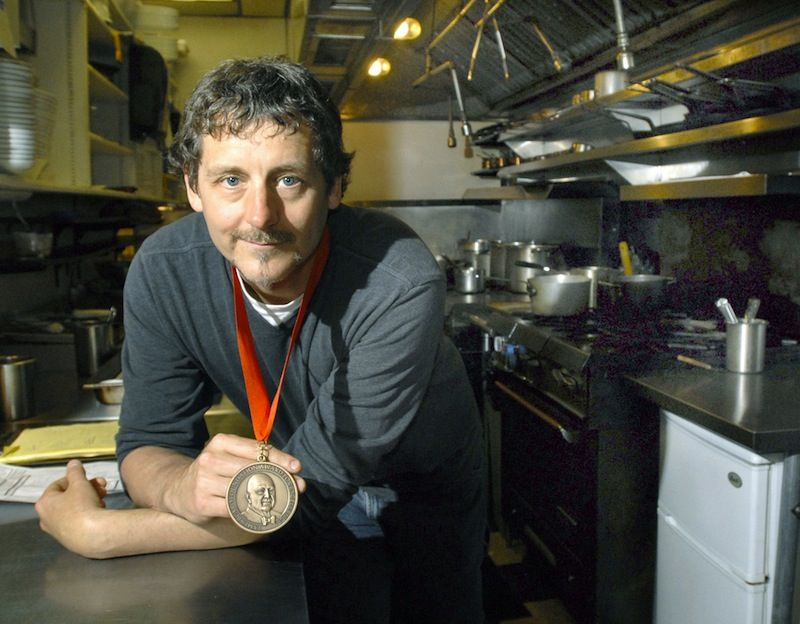 Chef Rob Evans, the owner of Duckfat and former owner of Hugo's in Portland, holds his 2009 James Beard Foundation best chef award.