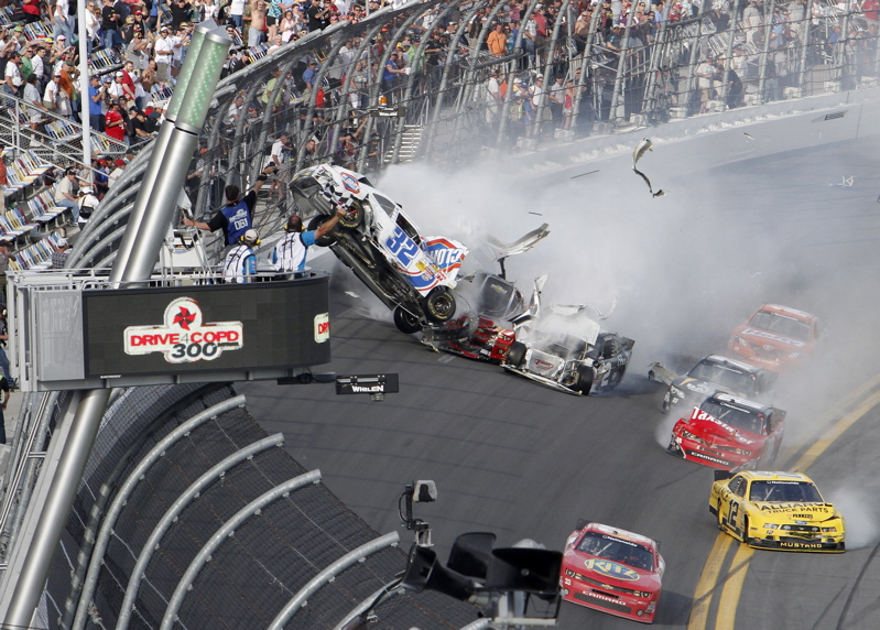 Kyle Larson's car goes airborne during a multicar wreck on the final lap of the NASCAR Nationwide Series race Saturday at Daytona International Speedway. Tony Stewart, front, avoided the crash and won the race.