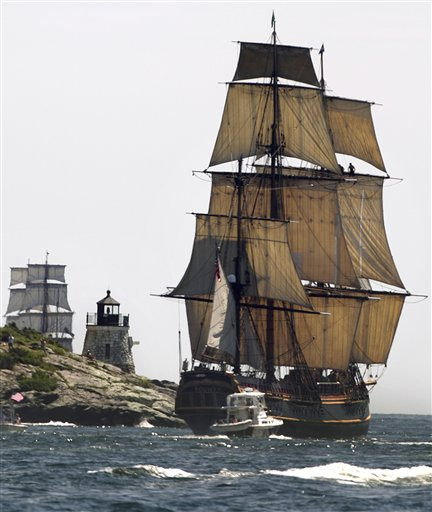 FILE - In this July 9, 2012, file photo, a replica of the historic ship HMS Bounty, right, sails past a lighthouse, center, as it departs Narragansett Bay and heads out to sea off the coast of Newport, R.I. The ship sank during Hurricane Sandy with 17 people aboard. (AP Photo/Steven Senne)