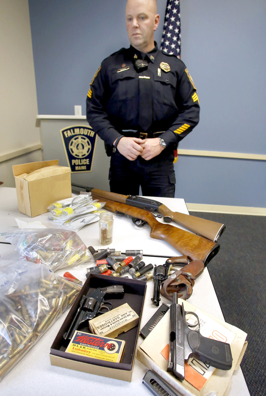 Falmouth Police Sgt. Frank Soule with guns and ammunition donated Saturday. Sales of some of them will benefit Special Olympics Maine.
