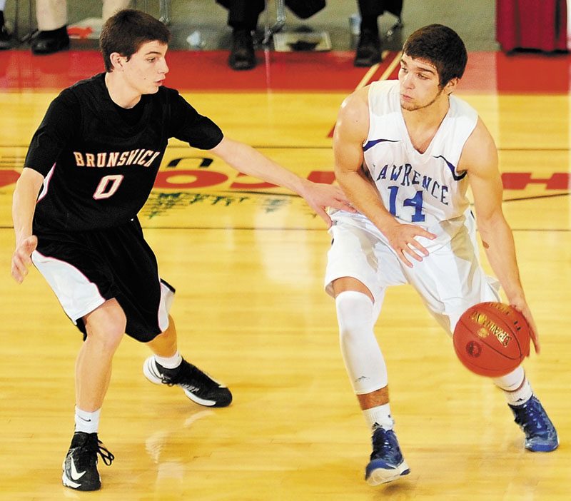 Brunswick's Blake Gordon, left, tries to stop Lawrence's Spencer Carey during an Eastern Class A tournament game on Saturday February 16, 2013 at the Augusta Civic Center.