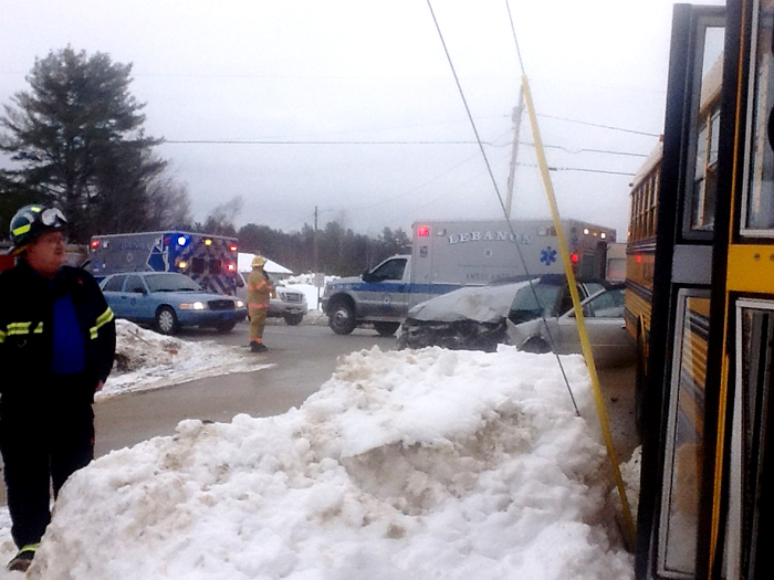 The crash scene Tuesday morning in Lebanon. The bus, shown at right, was reportedly coming off of Lower Middle Road when it collided with a car traveling westbound on Route 202. Photo provided by Lebanon Rescue Department.