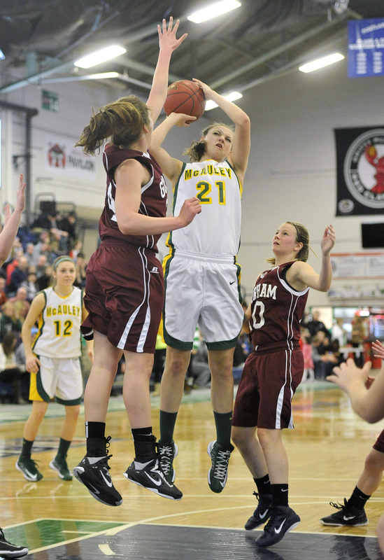 Olivia Smith tries to get a shot past the outstretched arm of Gorham's Kristin Ross during top-ranked McAuley's46-31 victory Monday night in a Western Class A quarterfinal at the Portland Expo.