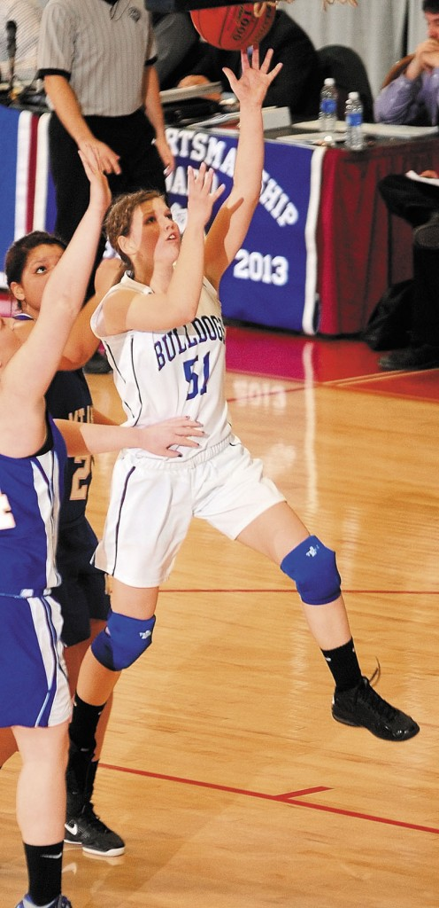 Madison's Kirstin Wood goes up for a shot during a Western Class C quarterfinal against Mt. Abram on Tuesday at the Augusta Civic Center.