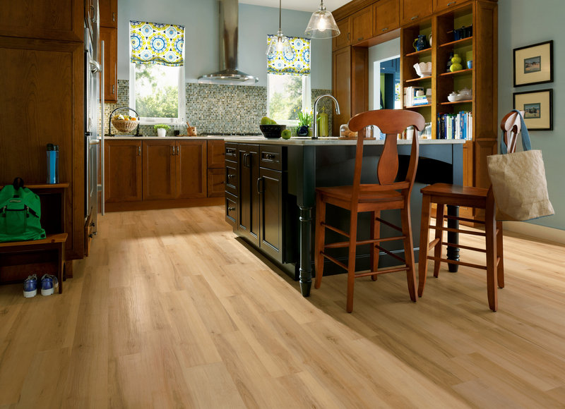 Armstrong's LuxePlank is a good choice for high-moisture areas and in kitchens, as shown here.