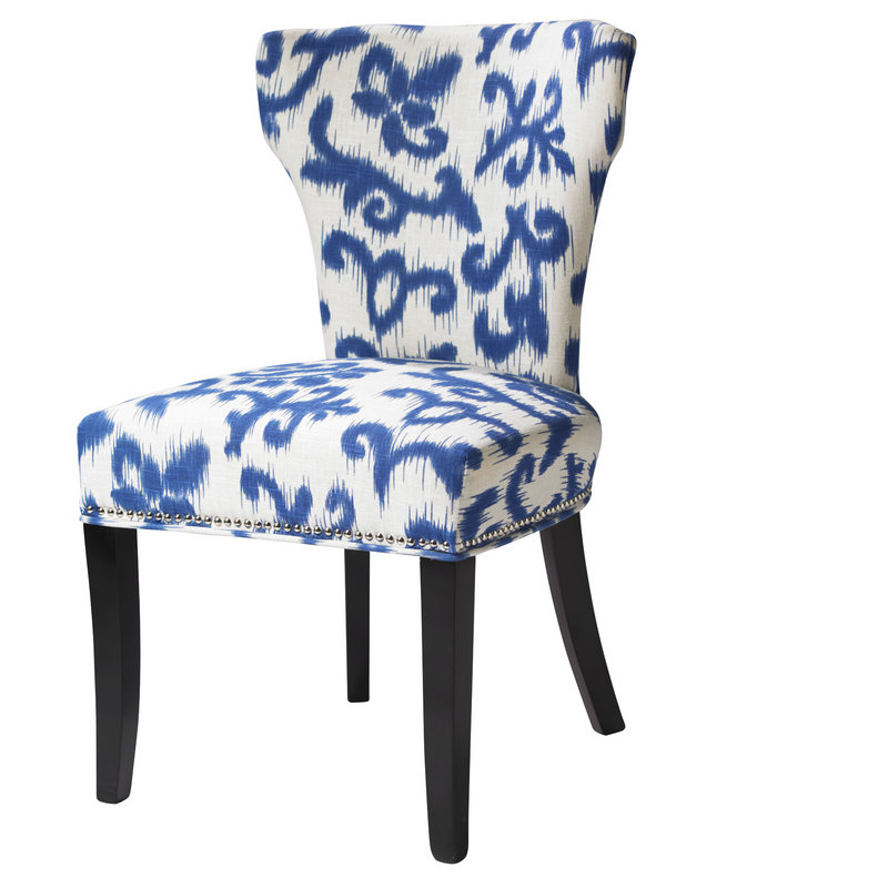 An upholstered chair in a blue and white print, also from HomeGoods.