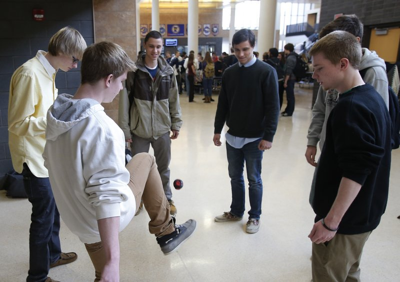 "Students play hackie sack to relax during a 20-minute ""recess"" at Chanhassen High School in Chanhassen, Minn."