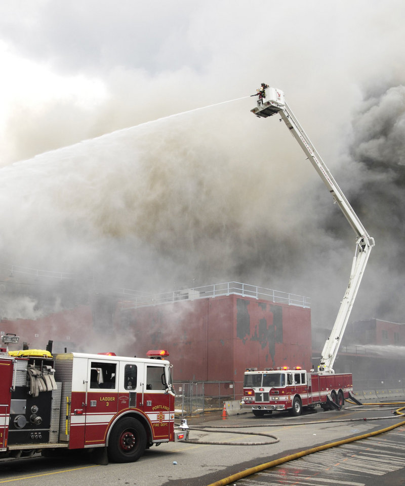Portland personnel fight a blaze at the Jordan's Meats plant on Middle Street in 2010. The lives of firefighters and community members are threatened because the city fire department isn't able to staff fire trucks at levels established under the national fire safety code, a reader says.