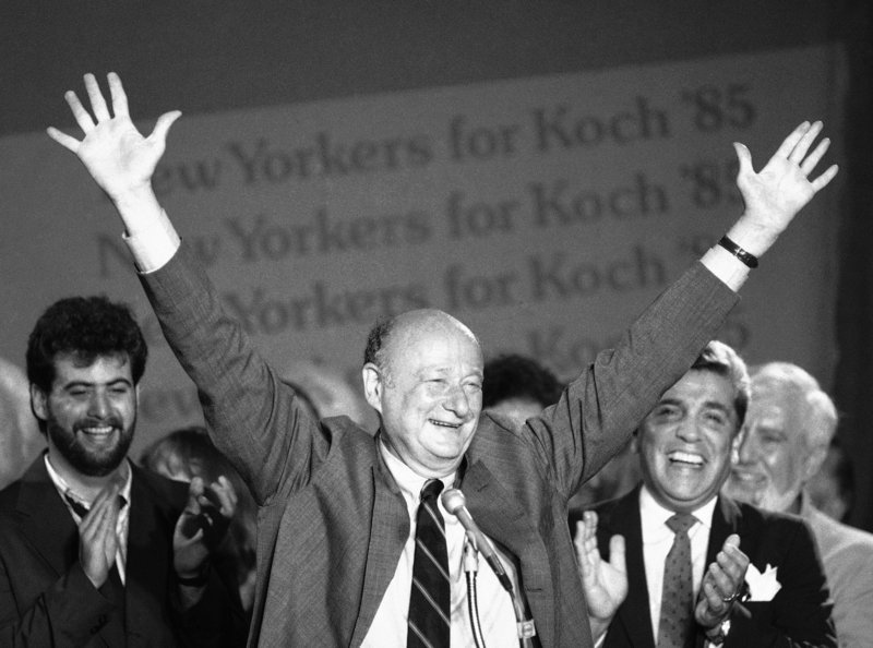 New York Mayor Ed Koch raises his arms in victory at the Sheraton Centre in New York after winning the Democratic primary in his bid for a third four-year term on Sept. 11, 1985.