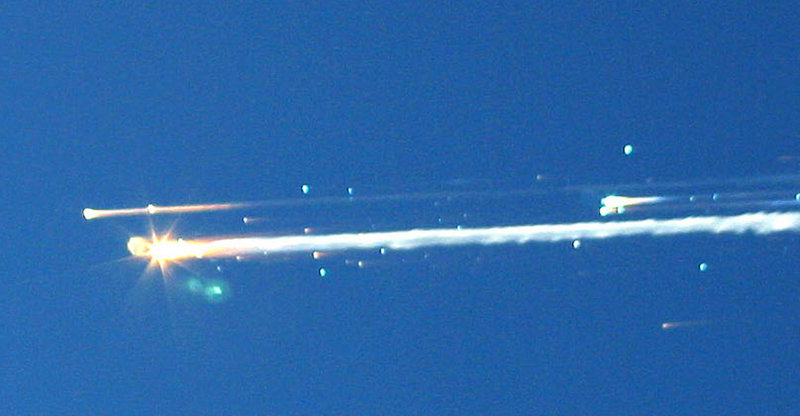 Debris from the space shuttle Columbia streaks across the sky over Tyler, Texas, on Feb. 1, 2003.