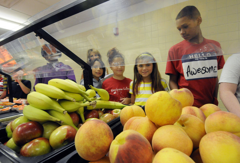 Under new rules proposed Friday by the USDA, most snacks sold in schools would have to have less than 200 calories. The rules also would set fat, sodium, calorie and sugar limits on almost all foods sold in schools.
