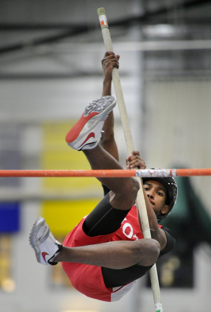 Michael Cuesta of South Portland keeps his focus Saturday in the pole vault in the Southwestern indoor track meet at Gorham. The Scarborough boys and Thornton Academy girls triumphed.