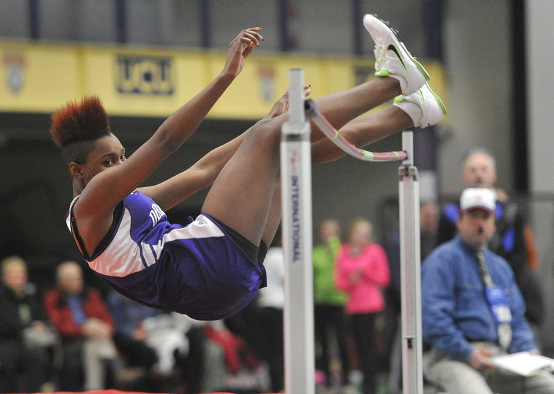 Rashad Zagon of Deering keeps her eyes on the bar, hoping it stays put Saturday while competing in the girls' high jump at the Southwesterns in Gorham. Zagon finished third in 4 feet, 10 inches. The Scarborough boys and Thornton Academy girls took team titles.