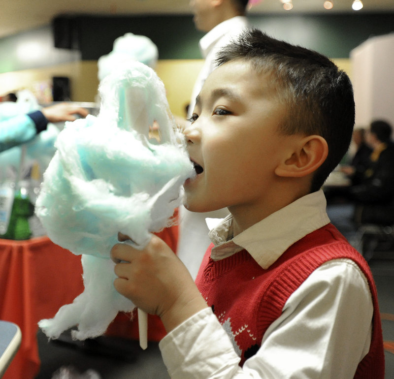 Ayden Tran, 5, enjoys cotton candy while celebrating the Vietnamese lunar new year in Portland on Saturday.