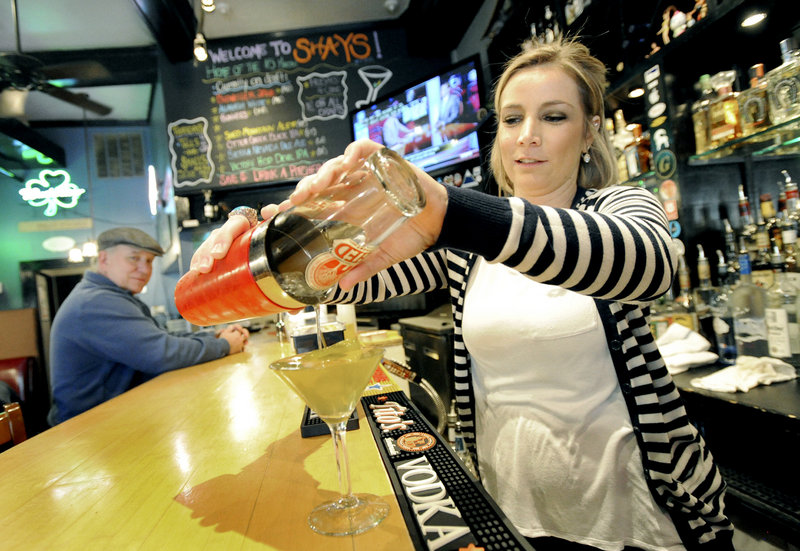 "Bartender Jennifer Brenerman pours a ""hot and dirty martini"" at Shay's Grill Pub in Portland."
