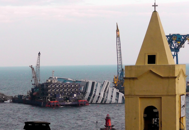 The cruise ship Costa Concordia leans on its side Jan. 11 of this year near the shore of the iisland of Giglio, Italy. Thirty-two people died when the ship ran aground on Jan. 13, 2012.