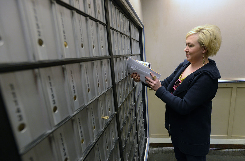 Moya Easterling of Limington picks up her mail at the Portland Post Office Wednesday, February 6, 2013.