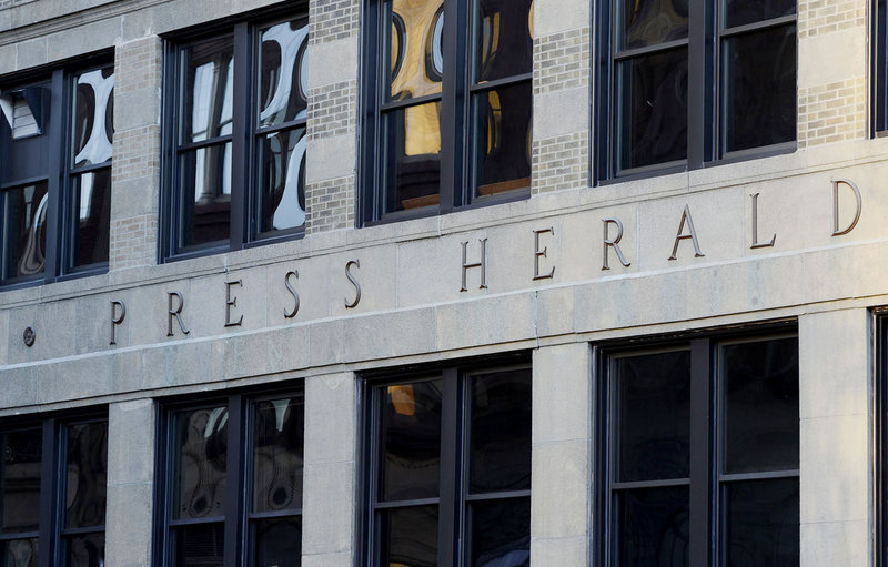 The sign on the old Portland Press Herald building at 390 Congress St. in Portland on Thursday, February 7, 2013.