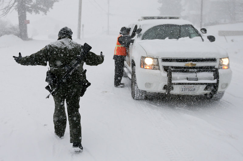 San Bernardino Sheriff's Department officer Steven Spagon mans a checkpoint Friday during the search for fired Los Angeles officer Christopher Dorner in Big Bear Lake, Calif.