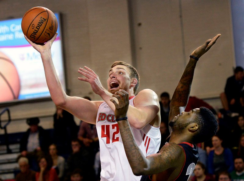 Garrett Stutz of the Red Claws goes up for a shot as Springfield's Willie Reed defends Sunday at the Expo. Stutz was one of five players who scored in double figures for Maine in a 104-100 victory.